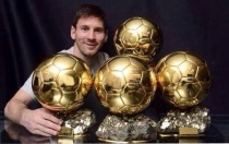 messi with trophies