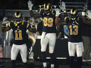 Image from: http://cdn.breitbart.com/mediaserver/Breitbart/Breitbart-Sports/2014/11/30/Rams%20Hands%20Up%20Dont%20Shoot.jpg